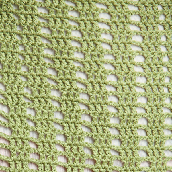 Close up of the stitches of the Sweetgrass Crochet Top