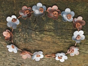 Learn how to make a necklace with copper and aluminum and celebrate spring jewelry in this FREE eBook.