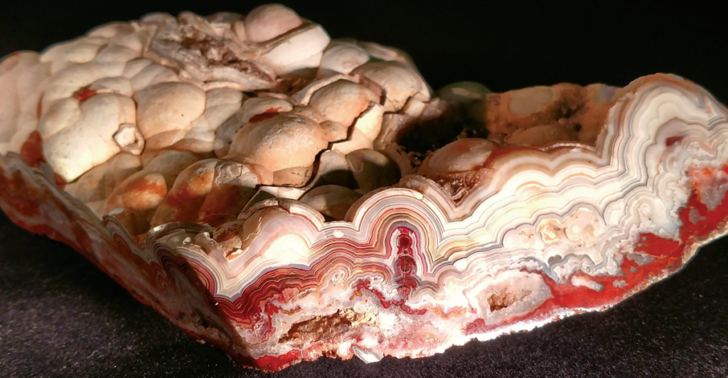 ABOVE: Bumpy contours on the unbroken surface of this chunk of crazy lace agate reveal intricate bands of color on the inside. Photo: Lexi Erickson