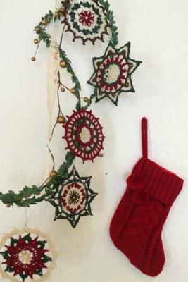 An assortment of crochet mandalas turned into crochet Christmas ornaments.