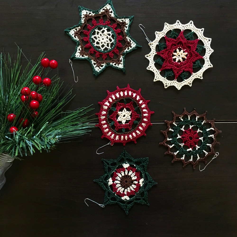 Crochet ornaments made of from crochet mandalas stiffened with fabric stiffener.