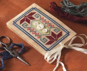A cross-stitched needle book