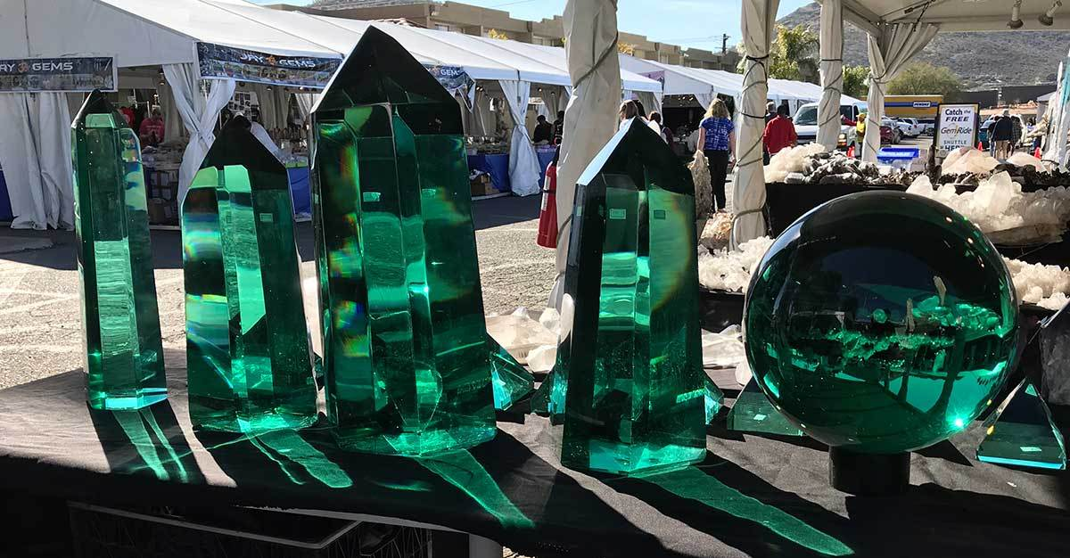 Polished crystals in the Cristais Maia booth at the Pueblo Gem & Mineral Show