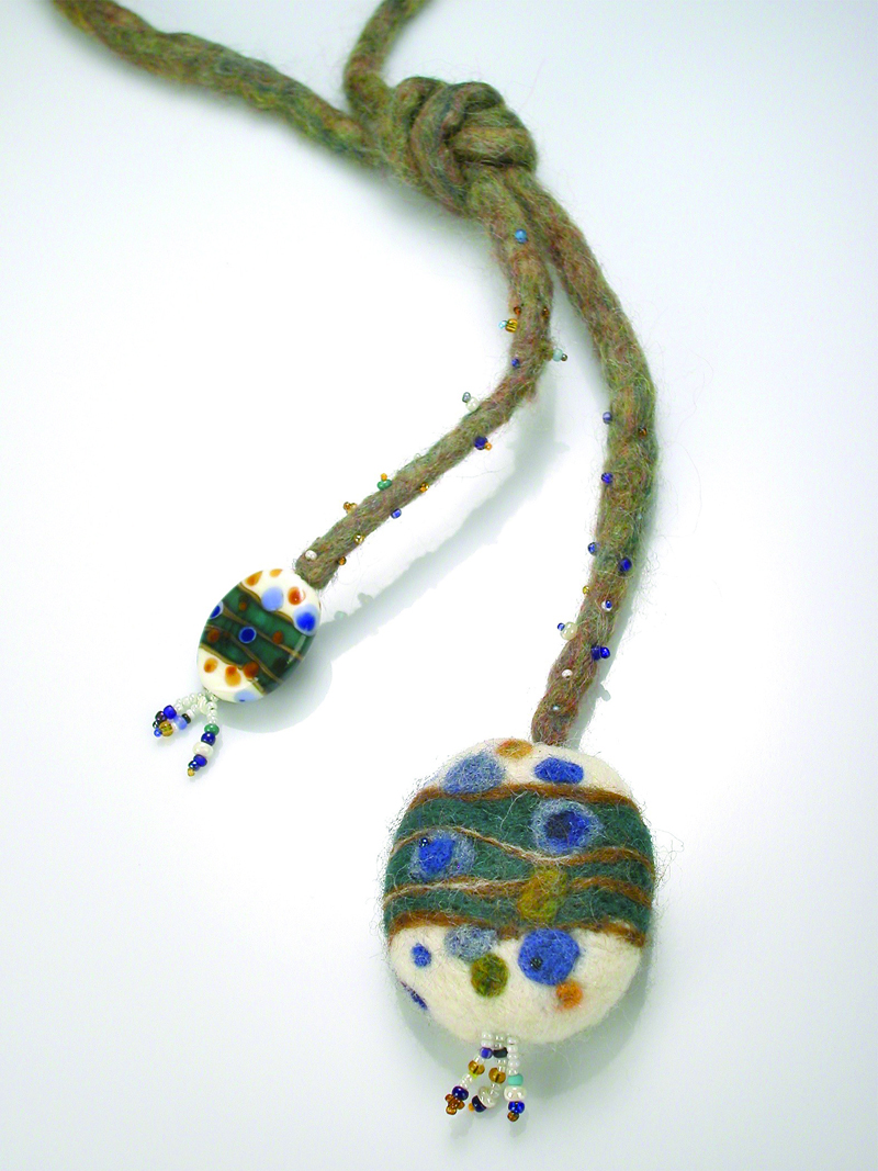 Carol loves combining the texture of beads and felt, such as in this handfelted lariat with doppelganger glass bead.