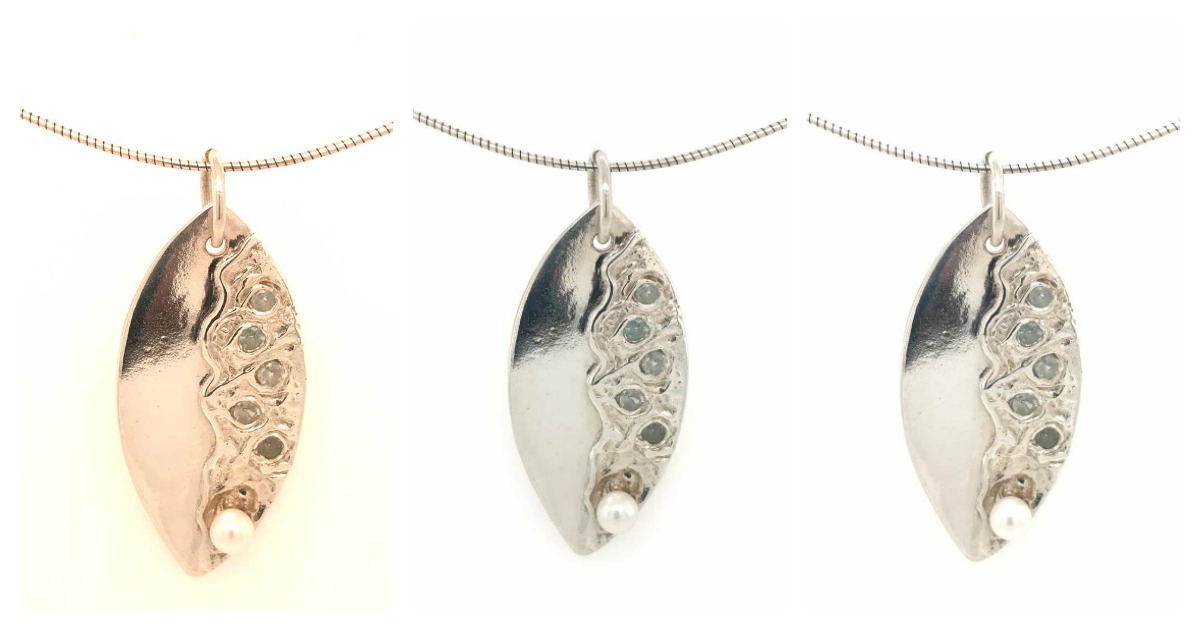 Fine-silver, sterling silver, CZs, pearl. Photo'd from the front of GemLightbox, captured to show the different light options: daylight (left), standard (center), and sparkle (right).