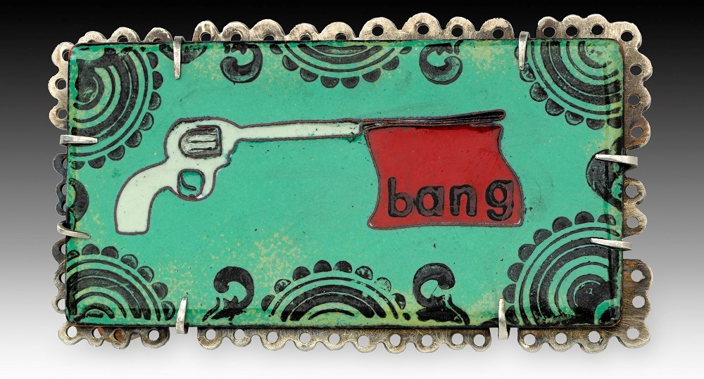 Bang! pin, cloissoné enamel on copper, nickel; photo: Randy Parietti