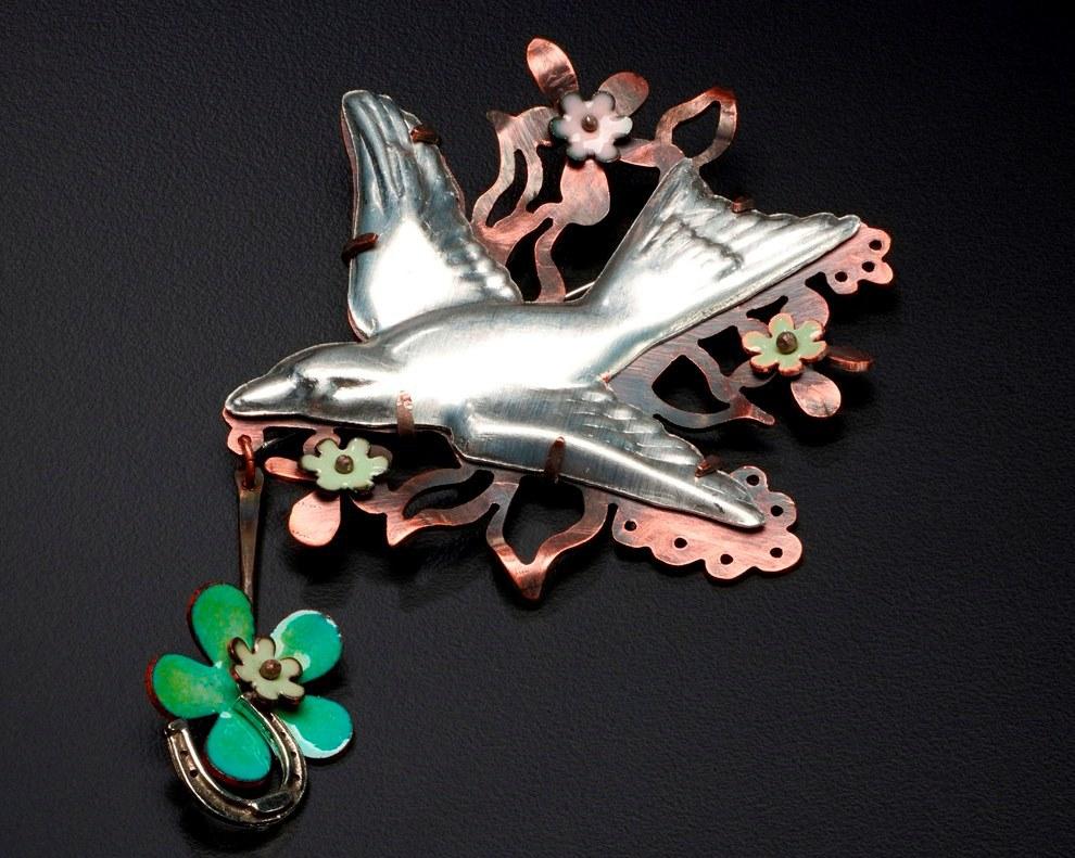 Lucky Bird pin, with enamel, copper, found bird and horseshoe, copper, enamel; photo: Randy Parietti