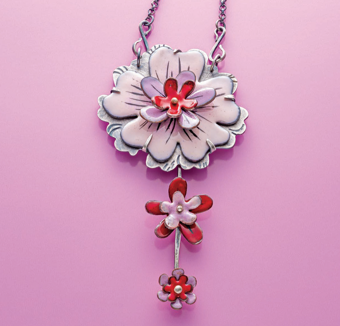 Kirsten's Torch Fired Enamel Floral Necklace project appeared in Lapidary Journal Jewelry Artist April 2016; photo: Jim Lawson