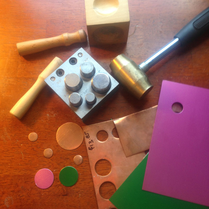 Jewelry making with disc cutter and a dapping block