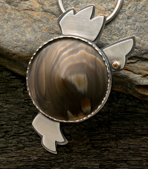 Learn how to make a wire-wrapped pendant with petrified wood in this free eBook on gemstone jewelry making.