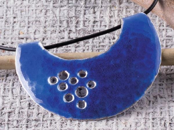 pierced enameled pendant by Pauline Warg