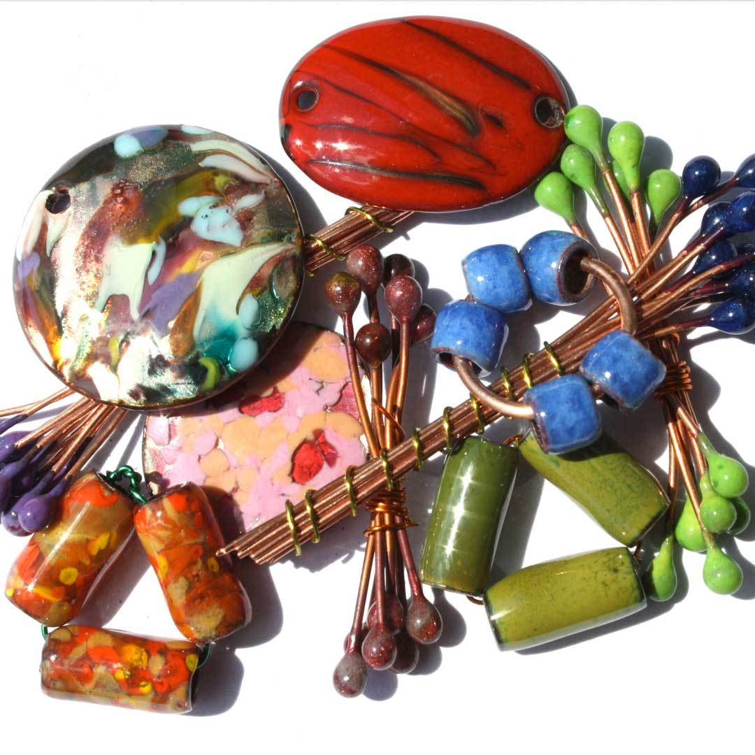 Learn torch fired enameling from the woman with over 20 years experience. In class you will make beads, pendants, and headpins you can use in your next jewelry design.
