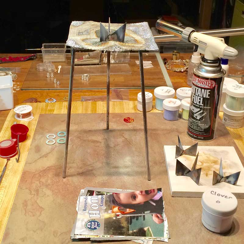 How to Make Enamel Jewelry with a Torch and Other Glass Art. Torch-fired enameling day in my studio.