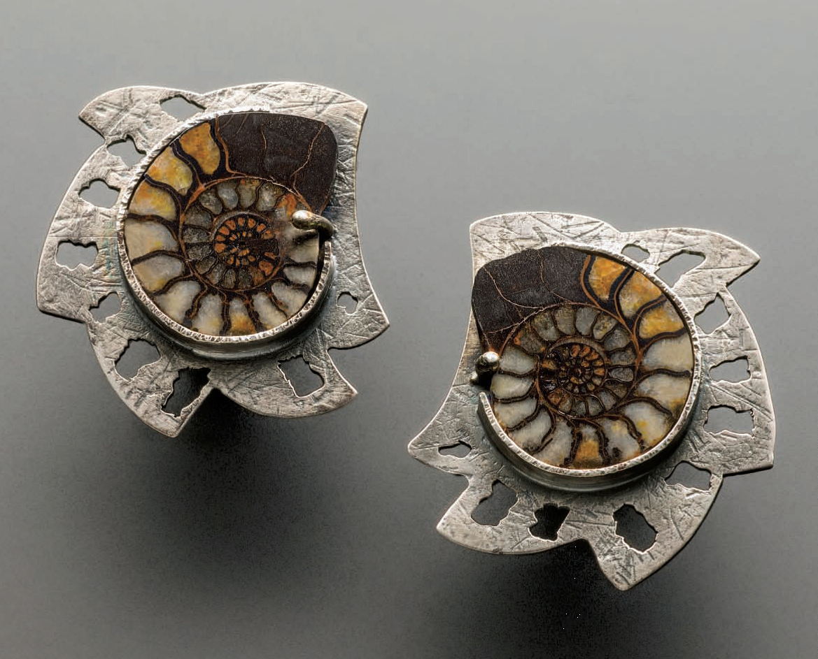 Ammonite earrings by Lexi Erickson show naturally formed spirals and the intricate pattern of the shell's chambers when seen in cross section. Originally published in Lapidary Journal Jewelry Artist April 2013; photo: Jim Lawson