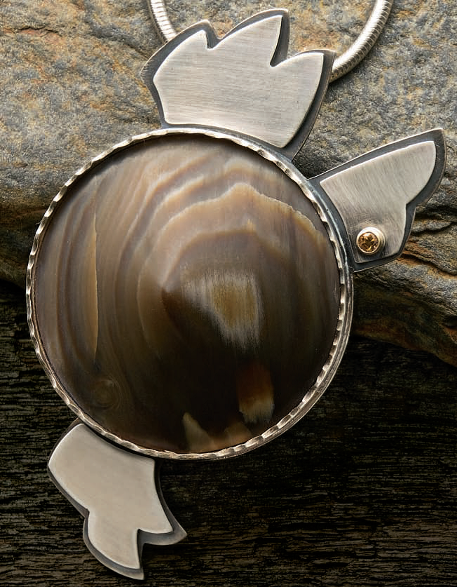 Lexi Erickson's Conical Petrified Wood Pendant project appeared in Lapidary Journal Jewelry Artist, February 2010; photo: Jim Lawson