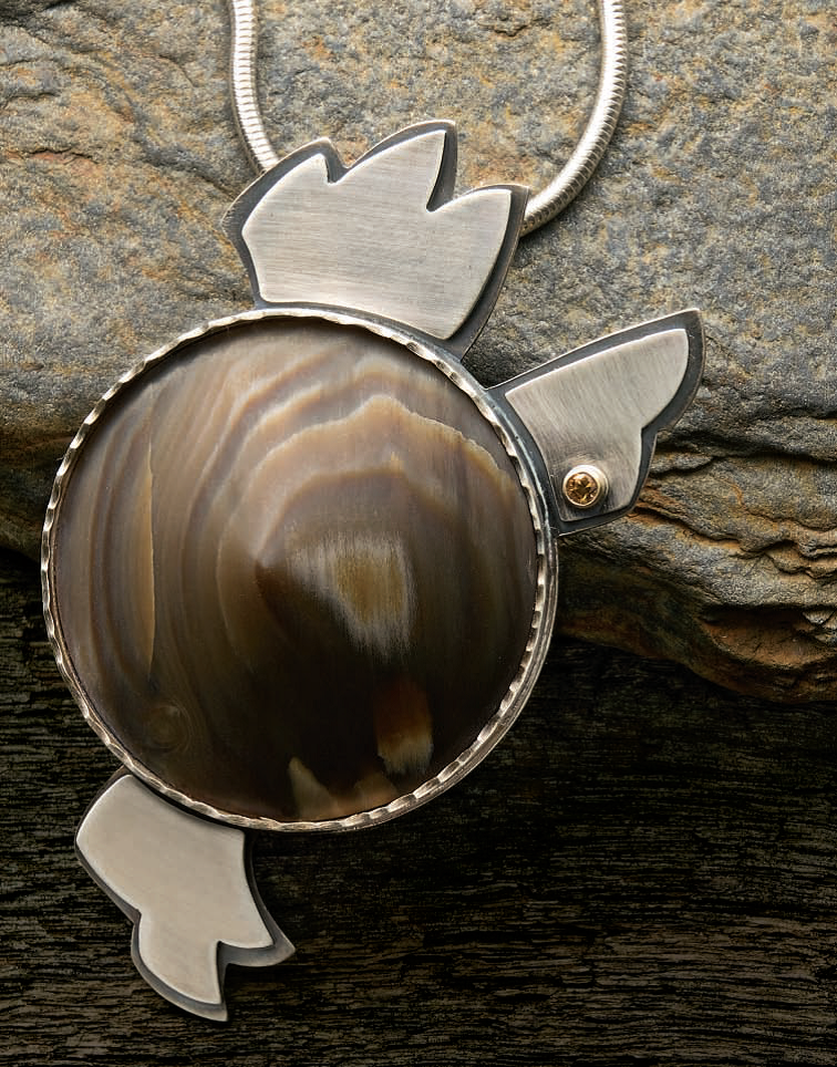 Conical Petrified Wood Pendant by Lexi Erickson, Lapidary Journal Jewelry Artist, February 2010; photo: Jim Lawson