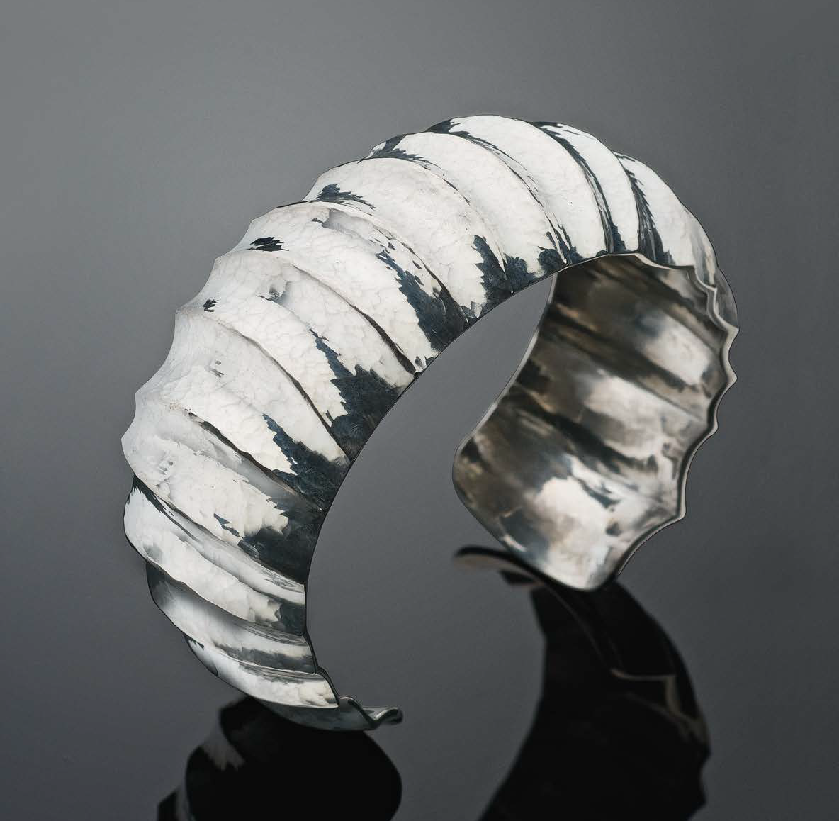 Bill Fretz relied on hammers and stakes to give this Argentium Fluted Cuff its mesmerizing handwrought texture. The project originally appeared in Lapidary Journal Jewelry Artist April 2011 and is now also available in the compilation 10 Sensational Silver Jewelry Making Projects Using Low-Tarnish Argentium® or Traditional Sterling. Photo: Jim Lawson