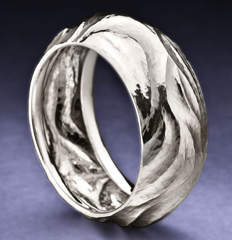 Planished and formed with hammers over pitch in a variation of chasing and repoussé, Bill's Argentium Hammered Bangle was originally published in Lapidary Journal Jewelry Artist, June 2008. Photo: Jim Lawson