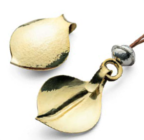On the back: the bead is convex on both sides; the leaf pendant is not. Photo: Jim Lawson