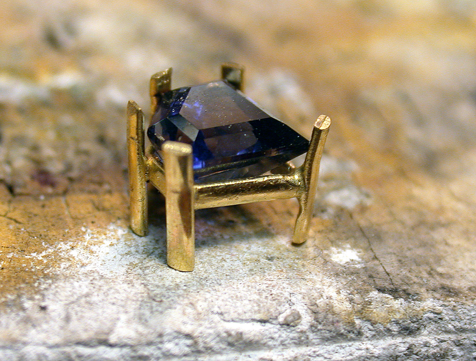 If you measure carefully enough, your stone should fit nicely on this setting once you bend the prongs out slightly, with the prongs lining up with the points of the stone. Photo: Noël Yovovich.
