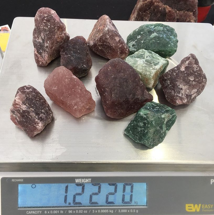 pink and green quartz rough gemstones from Ariel Treasures at Quartzsite, aka Cherry and Emerald Tanzurine
