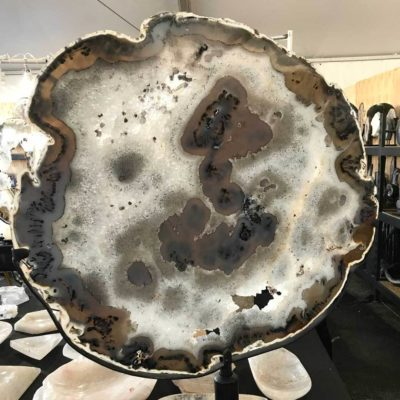 Slices of large geodes on display show their true beauty.