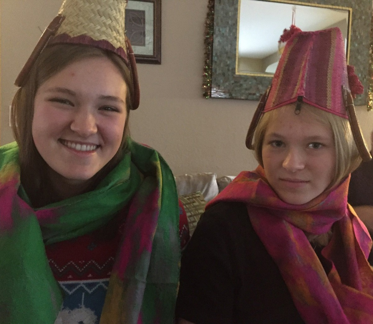 Kayla and Adriana Wowk modeling straw purses as fez-like hats, with semi-color-coordinated scarves, all purchased at the Tucson shows. PHOTO: MERLE WHITE