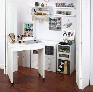 The Mobile Work Table can be easily wheeled into and out of storage.
