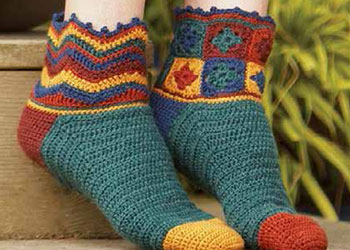 Crochet these cozy socks using granny squares in our free eBook on how to make a granny square and patterns.