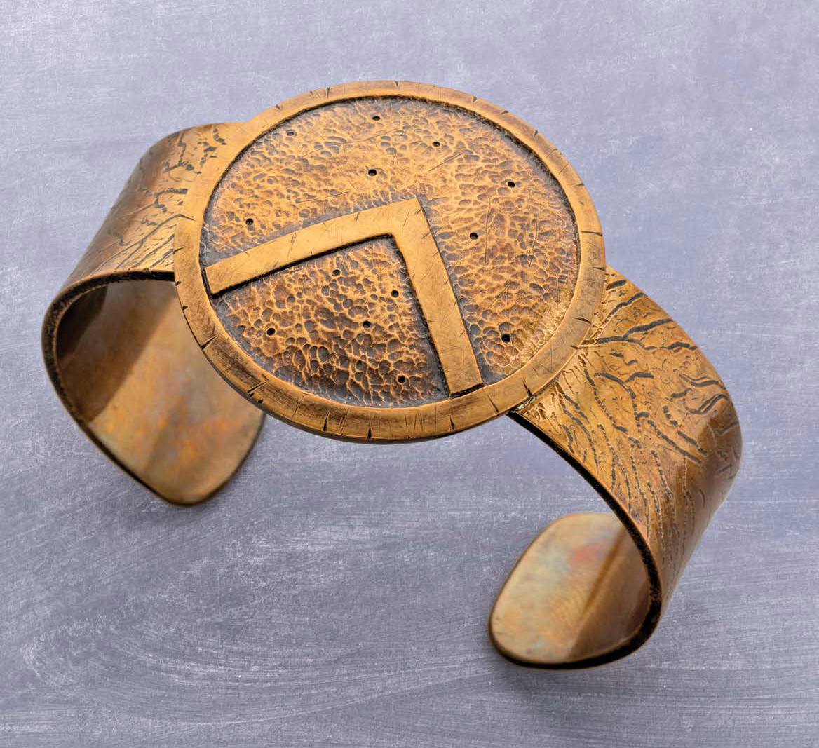Roger Halas walks you through making this bronze Spartan Cuff, an homage to the champions of ancient Greece. Roger includes how to give the bracelet that battle-hardened surface — great, easy techniques for texturing your metal even when you don't want to suggest such fighting prowess; photo: Jim Lawson