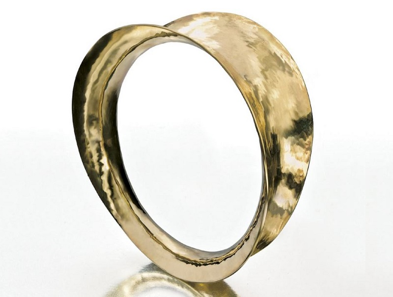 This Handwrought Brass Bangle sparked a new tool idea and two new bracelet designs. Originally published in Lapidary Journal Jewelry Artist July 2010. Photo: Jim Lawson
