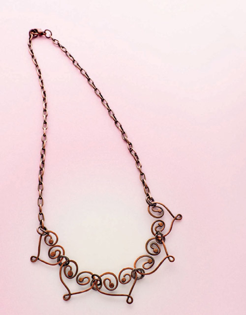 Learn how to make this etched copper necklace in our FREE eBook on copper jewelry making.