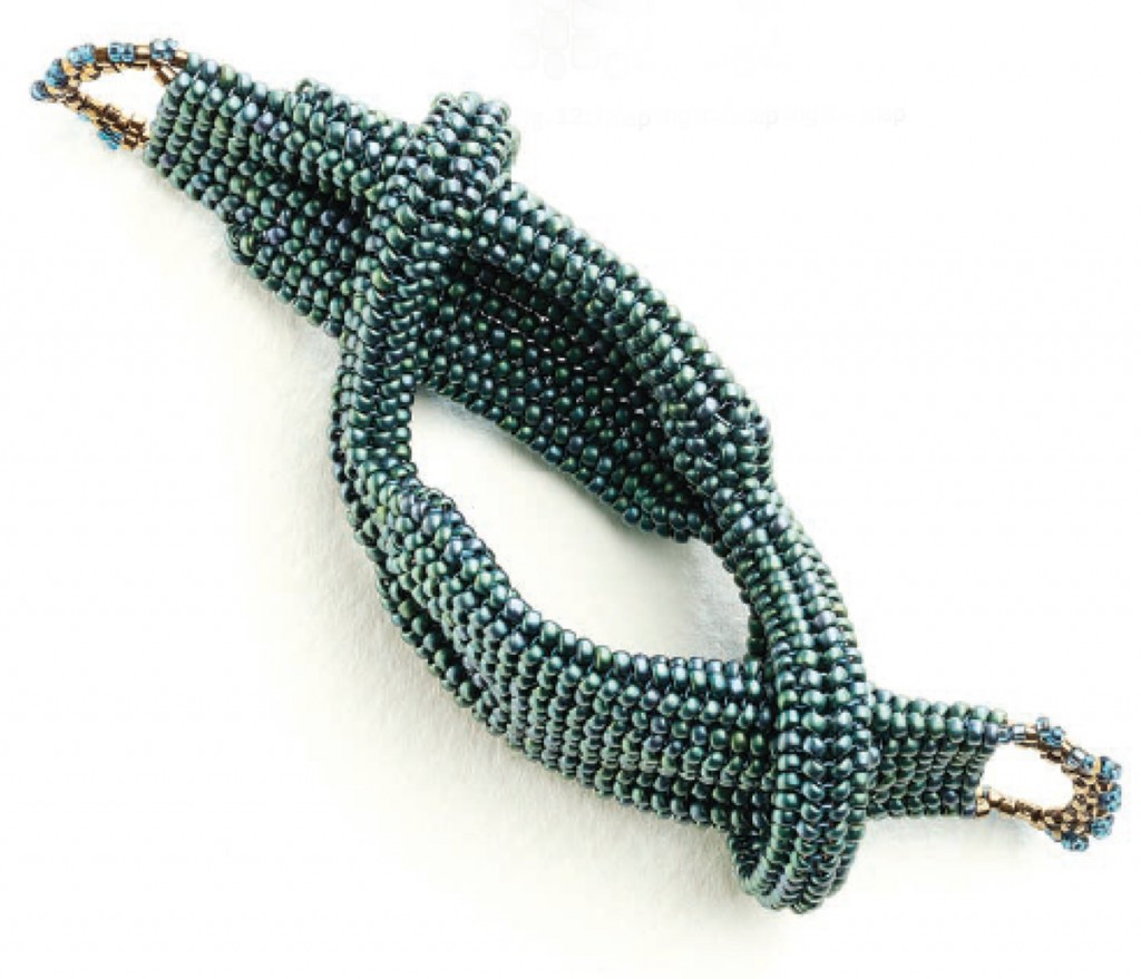 """Tubular herringbone sections are connected together forming the """"Hercules"""" knot in this bracelet design by Carole Horn."""