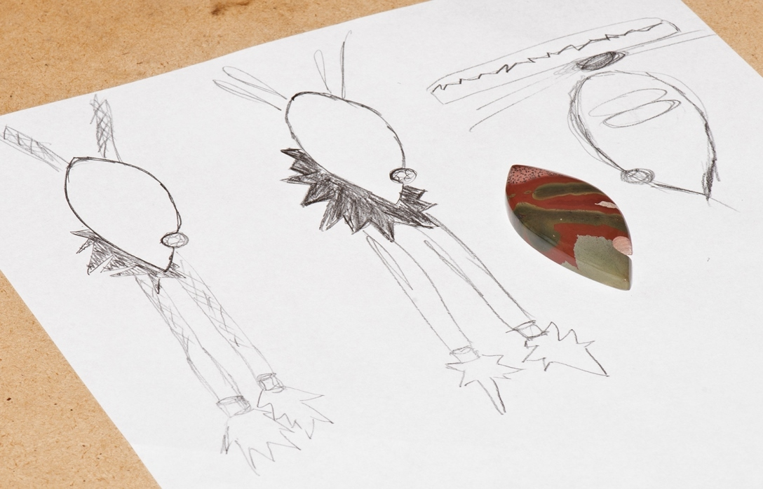 John sketched several designs for showcasing a new gemstone before committing to a bolo, and revised the cord holder along the way; photo: John Heusler