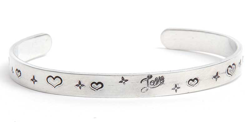 "personalized jewelry: Bracelet made using the Straightliner Jig by Danny Wade; ImpressArt bracelet blank and ""Love"" metal stamp; heart stamps and alpha star by Beaducation."