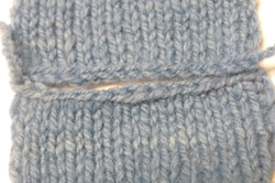 Mattress stitch knitting technique is used in this photo for a horizontal seam.