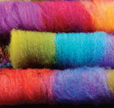 Learn about pseudorolags that involves using your stash of different textured and colored fibers sto create yarns with amazing depth, color and variety in this free wool combing and carding ebook.