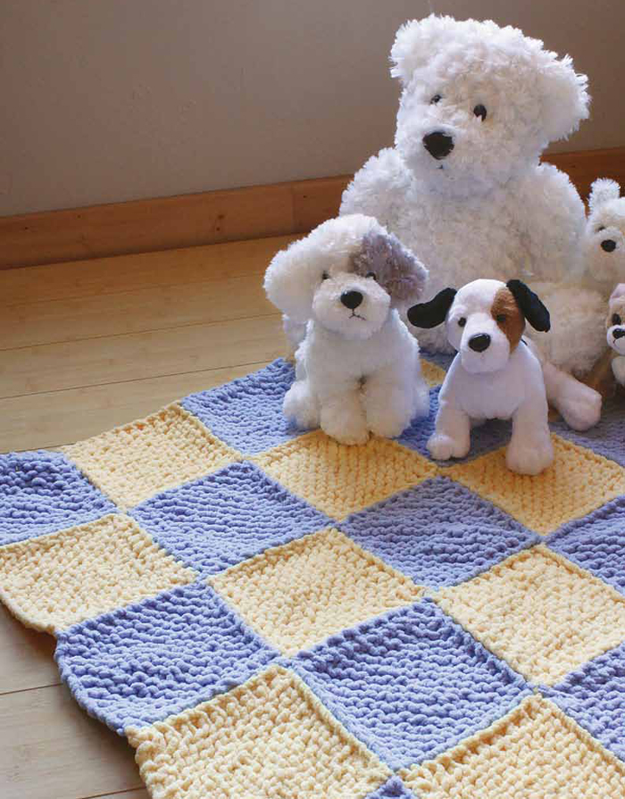 Learn how to knit this easy baby blanket pattern in this eBook on knitting for beginners.