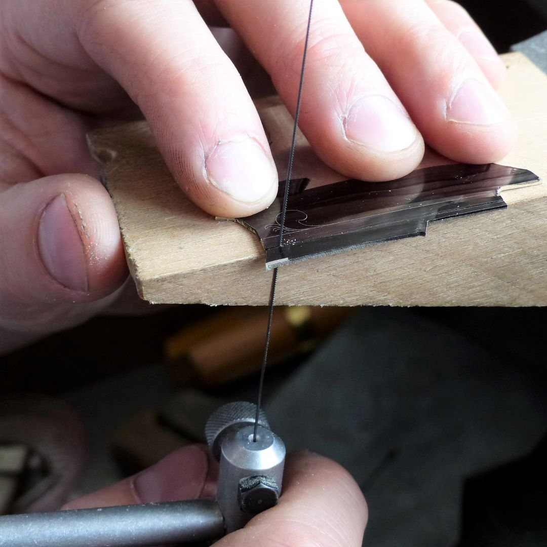The side of the bench block serves as a straight-line guide for sawing.