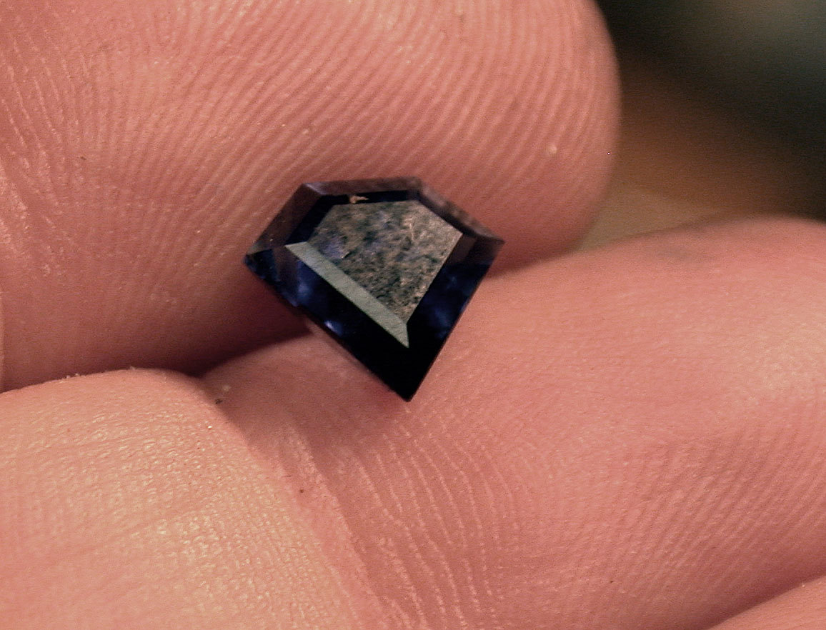 Shield-shaped faceted iolite. Photo: Noël Yovovich.