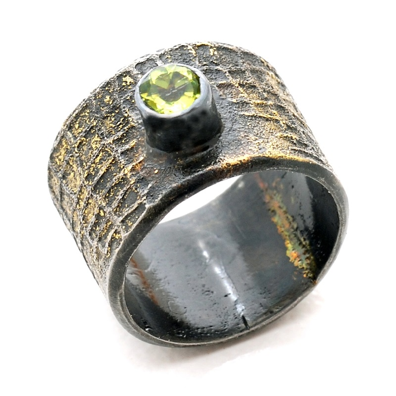 gold fused onto steel jewelry by jewelry artist Bette Barnett