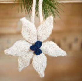 This image is of the Poinsettia Ornament. The Poinsettia Ornament is a holiday knitting pattern found in our free Knitting Gifts eBook.