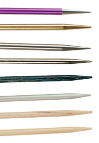 Learn about the different types of knitting needle materials, such as wood, metal, and more, in this free guide on knitting needles.