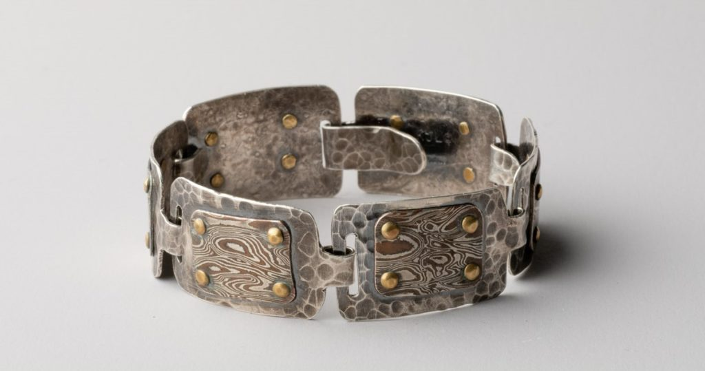 Karen J. Lauseng's cold-connected Cool Links bracelet originally appeared in Lapidary Journal Jewelry Artist March/April 2019; photo: Jim Lawson.