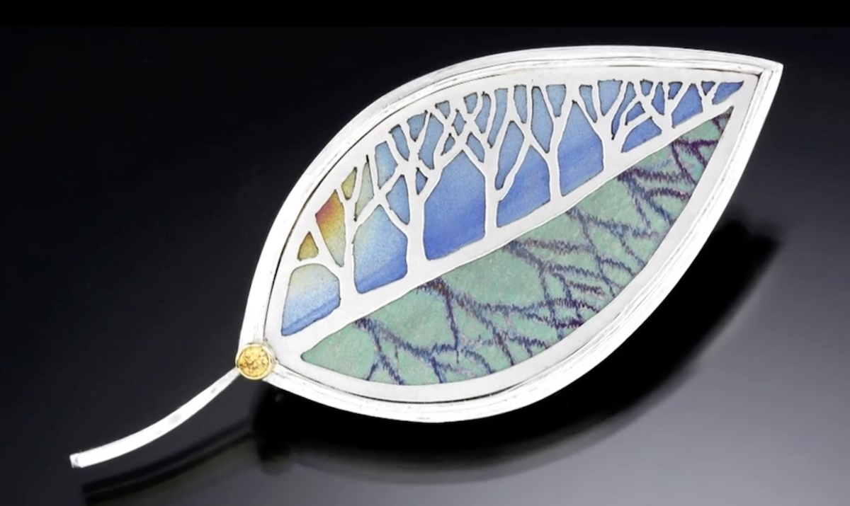 Beautiful pieces such as this leaf with a silver overlay show Noël's passion for coloring titanium.