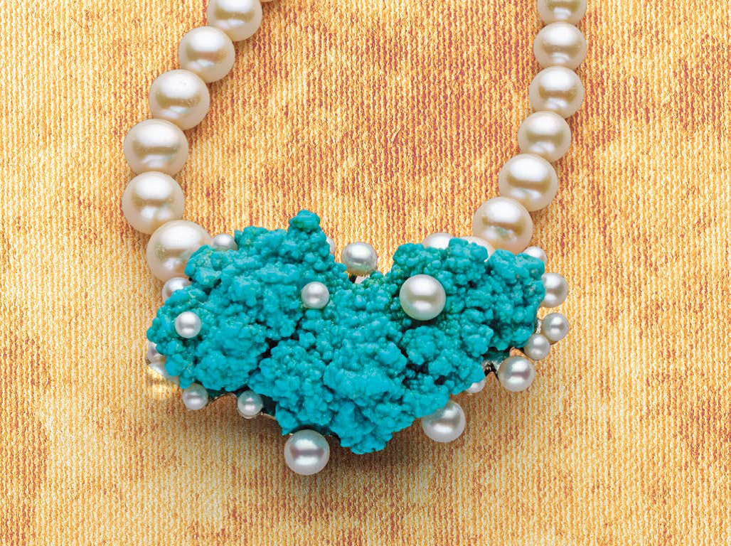 """The white pearl """"bubbles"""" atop this piece of seafoam-like turquoise are invisibly kept in place with an elaborate wireworked technique that maker Betsy Lehndorff developed just for this necklace. The Tiny Bubbles project appears in Lapidary Journal Jewelry Artist September/October 2018; photo: Jim Lawson"""