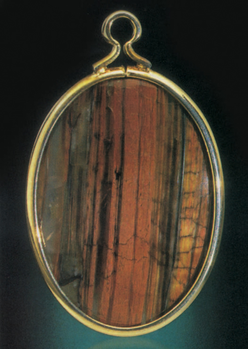 Learn how to make gemstone jewelry, like this tigereye pendant, in this free ebook.
