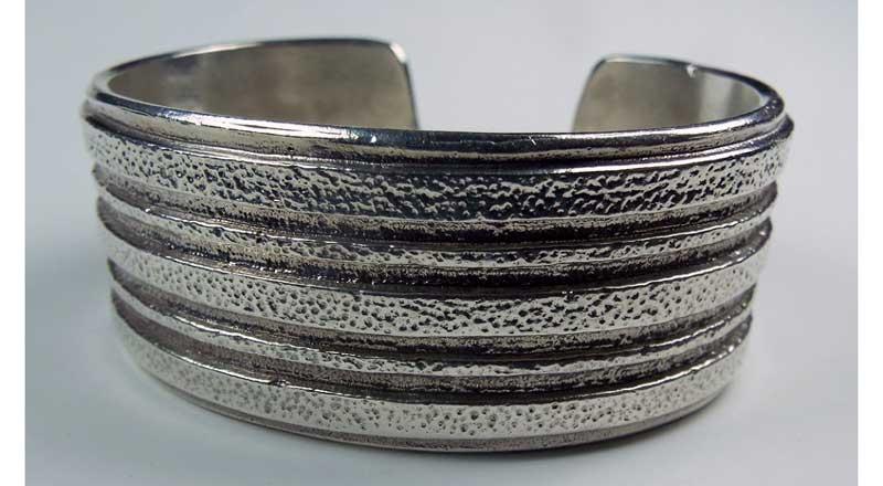 Tufa-cast silver cuff bracelet by Dallas Vuyaoma