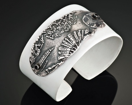 stretch your metal clay jewelry by embellishing other materials like this cuff by Mary Ann Nelson