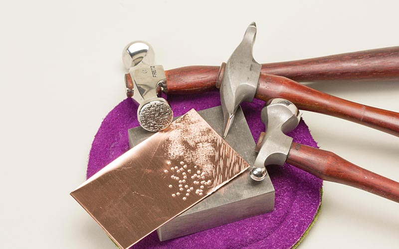 learn essential metalsmithing skills like texturing with hammers from Tracy Stanley